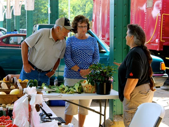Customers discuss recipes at L&N Train Station's Farmers Market.