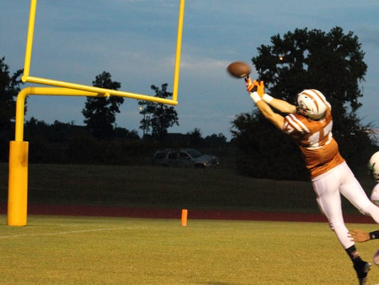 5. Tight end #17 Deauton Delgado making that last stretch for the ball.JPG