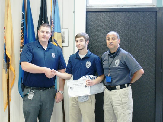 (From left) William Shropshire, Cumberland County Technical Education Center? supervisor; Jacob Bonanno, Student of the Month; and Andre Lopez, CCTEC law enforcement instructor.