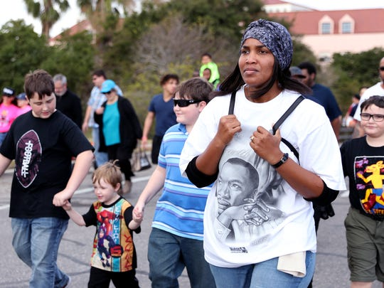 Shan Lusk marches in the 32nd annual Martin Luther