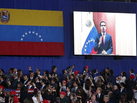 Venezuelan opposition leader Juan Guaido speaks via
