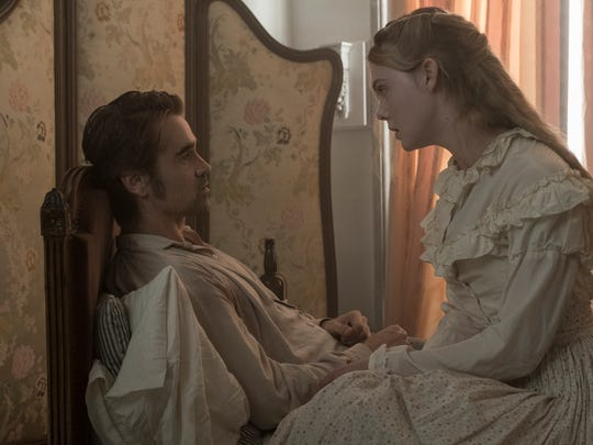 "Alicia (Elle Fanning) tends to John (Colin Farrell) in ""The Beguiled."""
