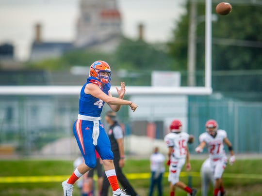 York High quarterback Micah Anciso throws during warmups against Reading before a football game on Friday, Sept. 1, 2017.