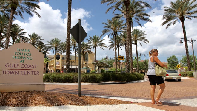 Gulf Coast Town Center is up for auction after the developer defaults on loan.