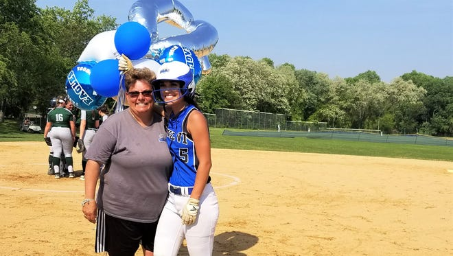 Paul VI senior second baseman Dallas Urban celebrates career hit No. 100 on Tuesday with her aunt and coach, Dawn Mader.