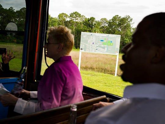 Passengers listen to plans on Thursday, July 27, 2017,