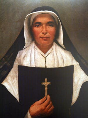 2/20/02  A painting of Mother Theodore Guerin hangs in a shrine to her inside the church on the campus of Saint Mary-of-the-Woods near Terre Haute IN.