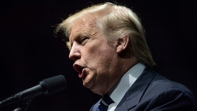 President-elect Donald Trump speaks in Grand Rapids, Mich. Friday. Trump's presidential transition team challenged the veracity of U.S. intelligence assessments that Russia was trying to tip the November election to the Republican. A top Senate Democrat demanded a full congressional investigation.