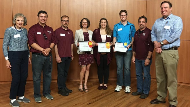 """NMSU's 2016 College of Arts and Sciences' """"Three-Minute Thesis"""" competition contest winners, third- place winner Tara Young; second-place winner Jean McKeever; first-place winner Ethan Dederick and judges from the college. This year's competition will take place at 9:30 a.m. Saturday, April 8, at Corbett Center Auditorium."""
