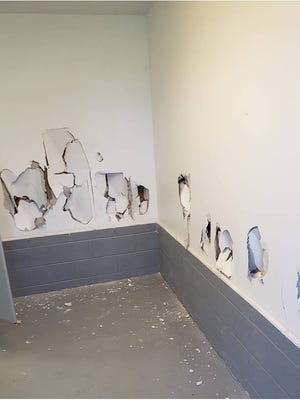 Police are looking for who punched about a dozen holes in the walls of a Rutherford rec bathroom