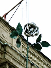 A white rose is suspended above Continental Square in anticipation of New Years Eve events in York City, Thursday, Dec. 29, 2016. Dawn J. Sagert photo