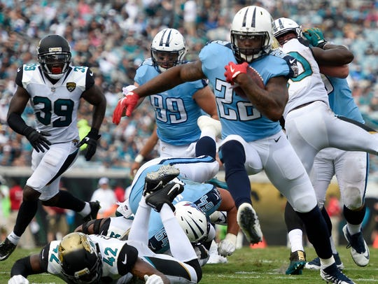 Tennessee Titans running back Derrick Henry (22) rushes