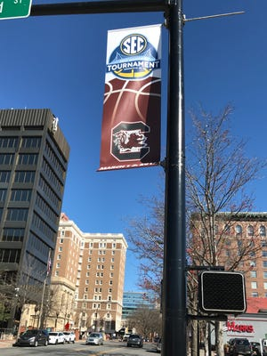 A banner for the SEC Women's Basketball Tournament featuring the University of South Carolina logo hangs at the corner of Main and Broad Streets downtown on Feb. 17, 2017