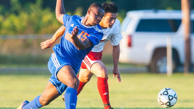 Vineland's Ali Sivri (24) battles for possession with Millville's Caleb White (15) at the Vineland Soccer Complex on Wednesday, September 20.