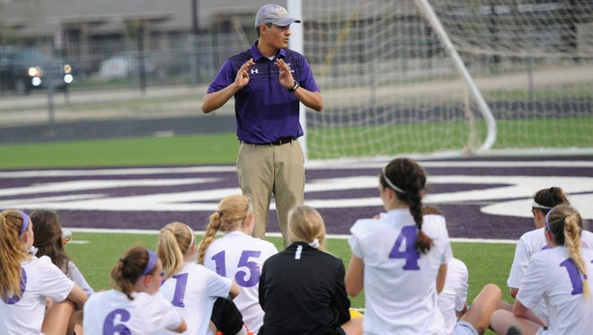 Wylie coach Manuel Cordova talks to his team during halftime of the Lady Bulldogs' 4-3 loss to Wichita Falls Rider at Bulldog Stadium on Monday, March 26, 2018.