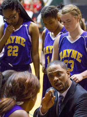 Rayne head coach Chester Randall speaks to players  in the Lady Wolves' 48-44 victory against St. Michael in the Allstate Sugar Bowl/LHSAA GirlsÕ Top 28 Basketball Tournament in Hammond March 3, 2016.