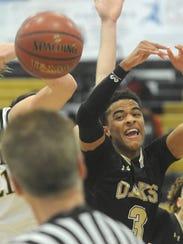 Oaks Christian's Jordan Jones, right, battles Ben Kaslow