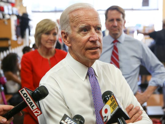 Joe Biden, former Vice President, speaks with media at Beyond Image Barber Salon in Camp Washington, Cincinnati, on Friday, June 29, 2018, after a fundraising event.