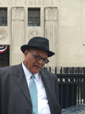 Stanley Johnson, 62, of Southfield, leaves federal court in downtown Detroit on May 5 after pleading guilty to accepting $84,000 in kickbacks from vendor  Norman Shy.