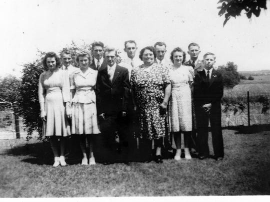 A Merkley family photo taken before the war. The four brothers who served in World War II are lined up in the back of the photo.