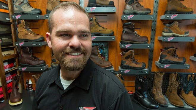 Red Wing Shoes owner Will McIntosh is pictured in his store on Friday, May 6, 2016, located at 142 Wyatt Drive. The business is celebrating 35 years at the same location, McIntosh has been operating the store since August of 2000.