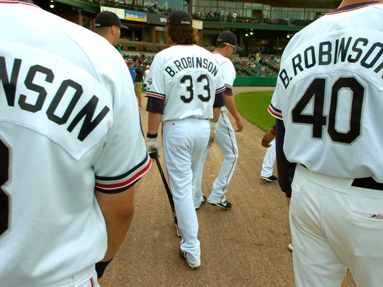 York Revolution players wore 'B. Robinson' nameplates on their jerseys Tuesday in honor of former Baltimore Orioles third baseman Brooks Robinson, who made his professional debut with the York White Roses in 1955.    [LegacyArchive] METRO - Everyone on the York Revolution team wore B. Robinson on their jersey's in honor of Brooks Robinson Tuesday, July 1, 2008. DAILY RECORD/SUNDAY ENWS - KATE PENN