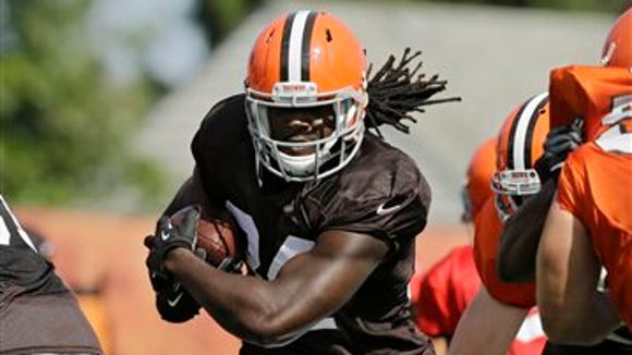 Cleveland Browns running back Isaiah Crowell runs the ball during team drills at NFL football training camp in Berea, Ohio Friday, Aug. 15, 2014. (AP Photo/Mark Duncan)