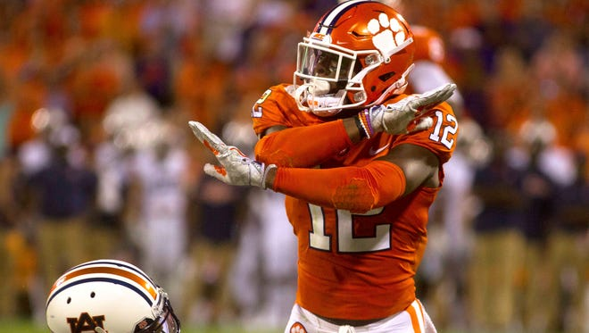 Clemson Tigers defensive back K'Von Wallace (12) makes a gesture after tackling Auburn Tigers wide receiver Ryan Davis (23) during the second quarter at Clemson Memorial Stadium.