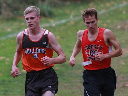 Heath junior Taylor Hopkins competes in the Division II district cross country meet at Watkins Memorial.