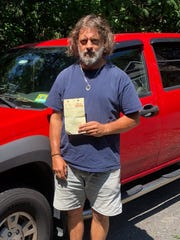 Mickey Holowach, of Englewood, New Jersey, with the $246 towing bill he got for parking in a private lot in Nyack on Aug. 16, 2018. Holowach learned Tuesday that he'll be getting $100 of that back, in the form of a gift card.