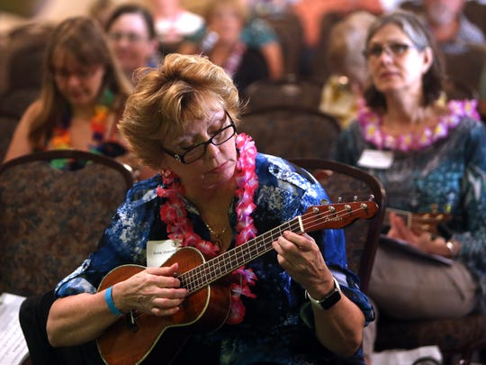 Anne Vicendese plays along as Curt Sheller teaches Beginner Uke 101 during the Folk Project's fourth annual ukulele festival with workshops at the Ukrainian American Cultural Center. August 27, 2016, Whippany, NJ