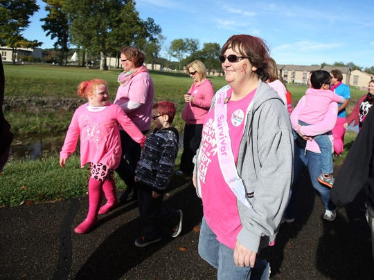Pam Strear walks with her team. About 400 people participated in the Making Strides Walk on Sunday Oct. 4, 2015. The walk is aimed to help fight breast cancer.