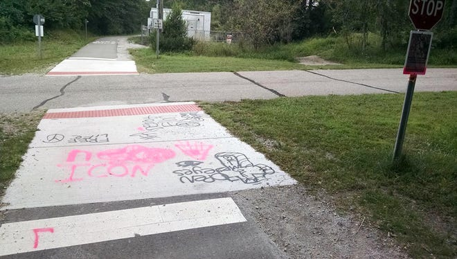 Graffiti was spray-painted on the Lakelands Trail Saturday.
