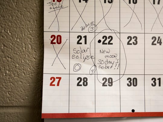 A July calendar, which hangs in Sarah Bear's room at