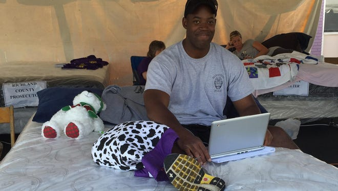 """Patrick Williams represents the Mansfield Police Department as the """"Great Sleep Out Against Domestic Violence"""" continues Saturday."""
