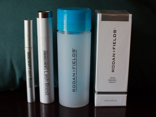 As a Rodan and Fields consultant, Winkie Dawkins wouldn't use anything but their products. From left to right is Lash Boost, which lengthens lashes, Hydration Cerium, which makes skin look younger by keeping it 200% more hydrated, and Roller Micro Needler Amph MD, which exfoliates and produces collagen. June 20, 2017.