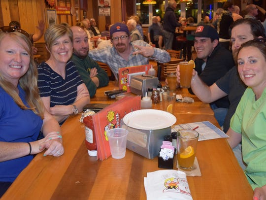 A group enjoys beer and trivia at a Let's Do Trivia