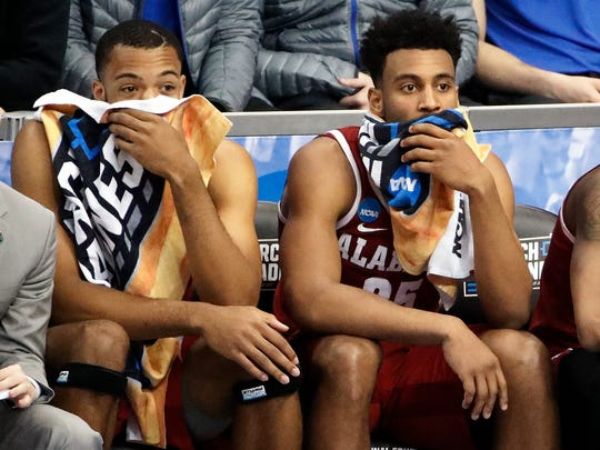 Alabama 's Braxton Key, right, sits with a teammate as time runs out in the second half of an NCAA men's college basketball tournament second-round game against Villanova in Pittsburgh, Saturday, March 17, 2018. Villanova won 81-58. (AP Photo/Gene J. Puskar)