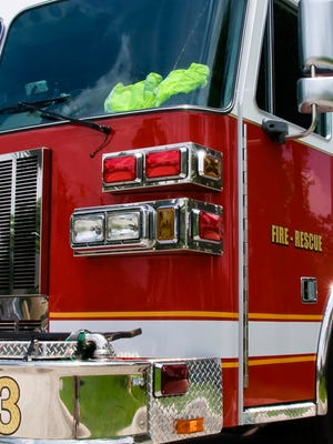 A file photo of a fire engines. Reno firefighters battled two residential fires that displaced at least 18 people.