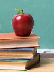 Public school books and apple