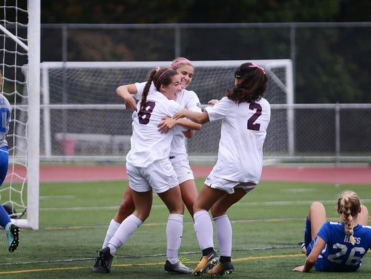 Ridgewood's Delaney Bessel (8) celebrating her goal