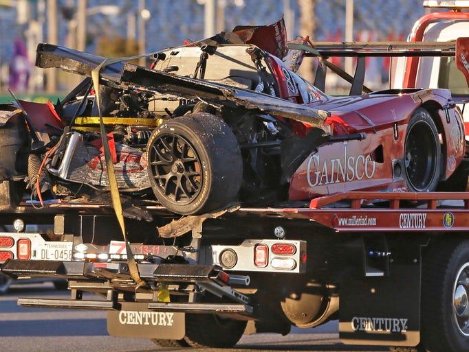Memo Gidley's Corvette is hauled away on a wrecker.