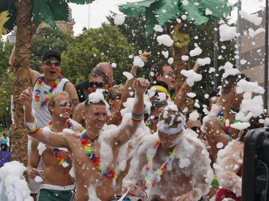 Men dance while being sprayed by soap suds on a float during the PrideFest parade, Sunday afternoon, June 13, 2010. (John Gaps III/The Register)