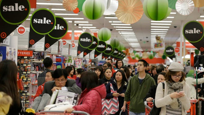A crowd of early Christmas shoppers swamps a Target Store in Colma, Calif., on Thanksgiving.