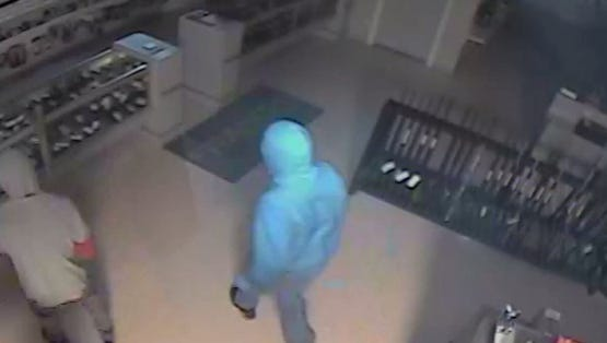 Surveillance footage of robbery suspects who broke into a Hendersonville gun shop.