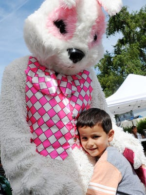 Jacob Macias, 4, and his new furry friend at the Hebbron Family Center's Spring Festival in Salinas.