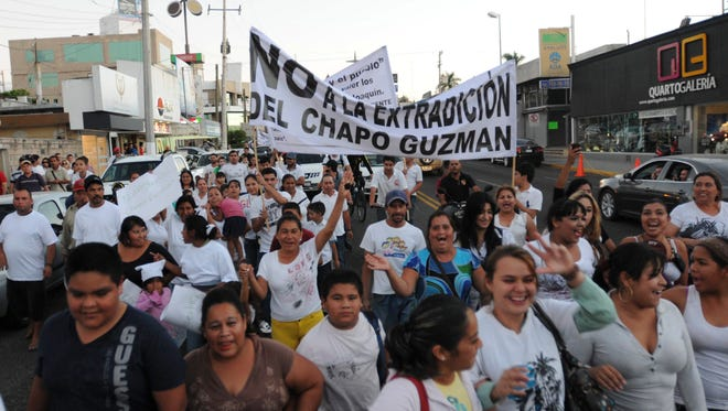 """People march in support of jailed drug boss Joaquin Guzman Loera, """"El Chapo"""" in the city of Culiacan, Mexico, on Wednesday."""