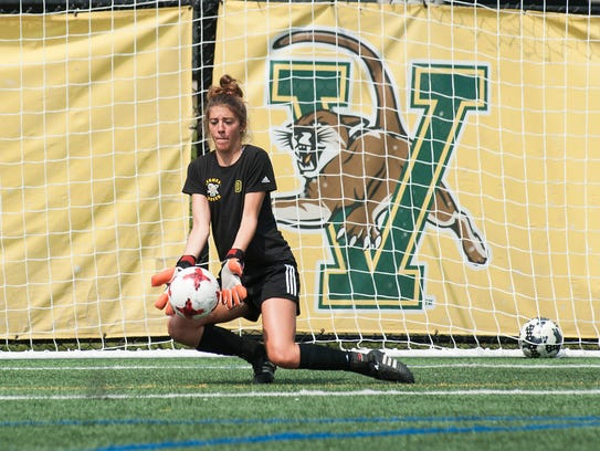 Goalie Coco Speckmaier stops a shot during the UVM