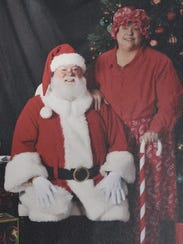 Downs, in full regalia, with wife Phyllis, Mrs. Claus.