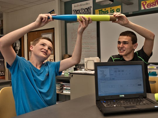 Delran Middle School students Connor Shanahan (left) and Ryan Wachter look over the rocket they are working on for a Blast Off event at Rowan University.